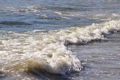 Rolling waves. Waves rolling at the beach Royalty Free Stock Photo
