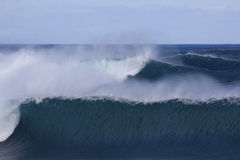 Rolling waves. Ocean turbulence illustrated by consecutive 20-30' waves rolling in to the Banzai Pipeline, Ehu Kai Beach, North, Shore, on the island of O'ahu Royalty Free Stock Image