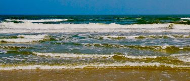 The rolling waves that arrive in the surf of the North Sea. On the Wadden Islands, of which Terschelling is one of them stock photography