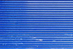 Rolling steel door in blue color royalty free stock images