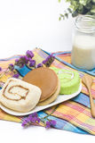 Rolljam, pancake and a jar of milk. On cloth Royalty Free Stock Photos