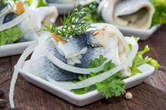 Rollmop on small plates Royalty Free Stock Image