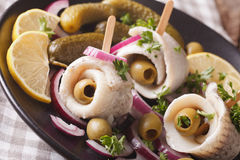 Rollmops herring with olives, onions and pickles close up. horiz Stock Images