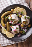 Rollmops herring with olives, onions and pickles close up. Verti Stock Photos