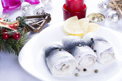 Rollmops with lemon for Christmas Stock Photos