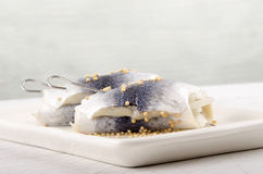 Rollmops with mustard seed on a plate Royalty Free Stock Photography