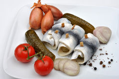 Rollmops on a white plate. Some fresh organic rollmops on a white plate stock photography