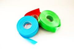 Rollo azulverde rojo de la cinta aislado imágenes de archivo libres de regalías