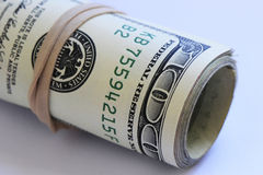 Rollo de cientos billetes de dólar Fotos de archivo libres de regalías