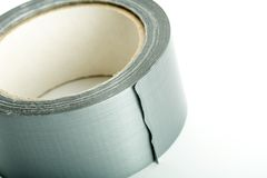 Rollo de la cinta adhesiva de plata Foto de archivo libre de regalías