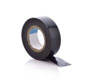 Rollo de la cinta aislante pegajosa negra en el fondo blanco Foto de archivo libre de regalías