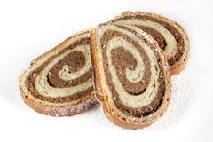 Rollo de pan de la nuez en el fondo blanco Foto de archivo libre de regalías