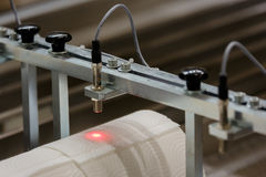 Rollo de papel con la dirección de laser Imágenes de archivo libres de regalías