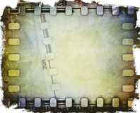 Rollo de película cinematográfico viejo con la tira de la película Fotos de archivo libres de regalías