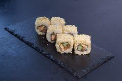Rollo de sushi con Comida japonesa 4 Fotos de archivo libres de regalías