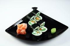 Rollo de sushi con los salmones Fotos de archivo