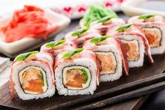 Rollo de sushi con tocino Imagen de archivo