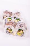 Rollo de sushi crudo de la gamba con la anguila Foto de archivo libre de regalías