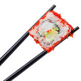 Rollo de sushi en palillos en blanco Fotos de archivo