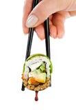 Rollo de sushi en un fondo blanco Foto de archivo libre de regalías