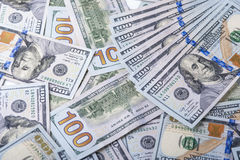 Rollo del dólar en el fondo de billetes de dólar Fotos de archivo