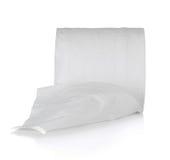 Rollo del papel seda en el fondo blanco Fotografía de archivo