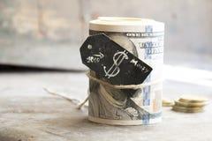 Rollo y monedas del dólar Fotografía de archivo