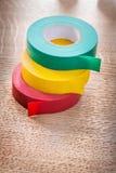 Rollos amarillos rojos verdes de la cinta aislante Fotos de archivo libres de regalías