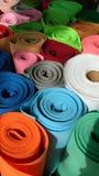 Rollos coloridos de la materia textil Foto de archivo libre de regalías