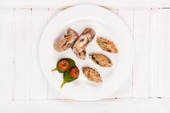 Rollos de carne con el tomate y la espinaca del arroz Foto de archivo libre de regalías