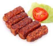 Rollos de carne rumanos asados a la parrilla - mititei, mici Imagen de archivo libre de regalías
