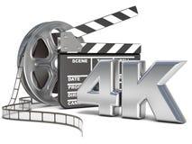 Rollos de película y tablero de chapaleta de la película icono del vídeo 4K 3d rinden Fotografía de archivo