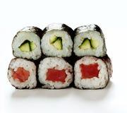 Rollos de sushi aislados en blanco Imagen de archivo libre de regalías