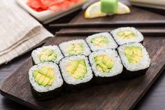 Rollos de sushi con el aguacate Fotografía de archivo