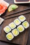 Rollos de sushi con el aguacate Imagen de archivo libre de regalías