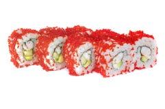 Rollos de sushi con el aguacate y el camarón del sésamo Imagen de archivo libre de regalías