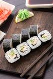 Rollos de sushi con la semilla de la anguila, del pepino y de sésamo Imagenes de archivo