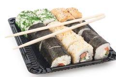 Rollos de sushi con los palillos Imagen de archivo