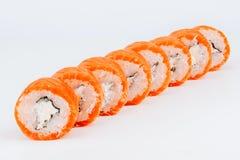 Rollos de sushi con los pescados de color salmón Foto de archivo libre de regalías