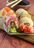 Rollos de sushi con los pescados rojos Imagen de archivo