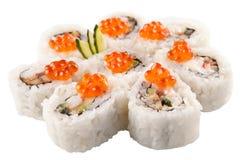 Rollos de sushi japoneses en el fondo blanco Foto de archivo libre de regalías