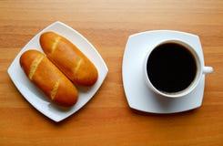 Rollos y café de pan francés Imagen de archivo
