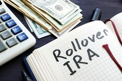 Rollover ira handwritten in a notepad. Retirement. Rollover ira handwritten in a notepad. Retirement concept royalty free stock photos