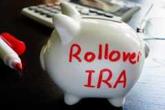 Rollover IRA. Rollover IRA written on a piggy bank royalty free stock image