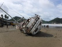 The Rollover Yacht beached in San Juan Del Sur royalty free stock photography