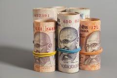 Rolls индийских изолированных рупий Стоковые Изображения