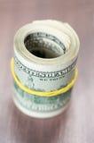Rolls 100 счетов доллара США Стоковое Фото
