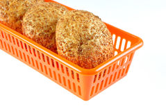 The rolls. With bran lay in the container Royalty Free Stock Photography