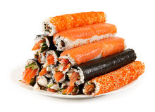Rolls. Japan rolls stacked on a plate. isolated on white background Royalty Free Stock Photo