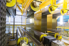 Rolls of aluminum extend on special machines. Of rolling mill Stock Photography
